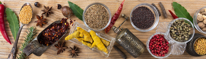 Fototapeta Vintage Variety of colorful spices on wooden background, top view, banner
