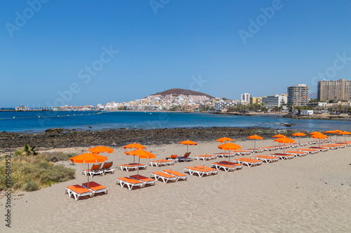 The Beach and sunbeds of Los Cristianos resort on Tenerife, Canary Islands, Spai Canvas Print