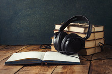 Books Stand With A Pile, Headphones, Outdoor Diary On A Wooden Background. The Concept Of Audio Books And Audio Education