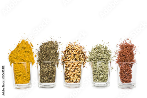 Cadres-photo bureau Herbe, epice glass jars with various spices on white background with copy space