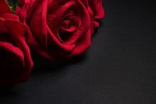 Close Up Of Red Roses On Black...