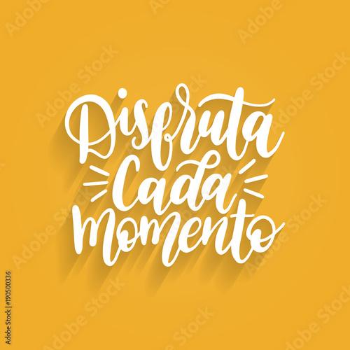 Fotografie, Obraz  Disfruta Cada Momento translated from spanish Enjoy Every Moment vector handwritten phrase on yellow background