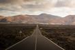 Rollercoaster road to Timanfaya volcano, Lanzarote, Spain.