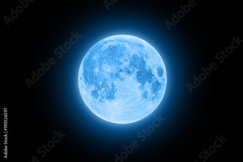 Valokuva Blue super moon glowing with blue halo isolated on black background