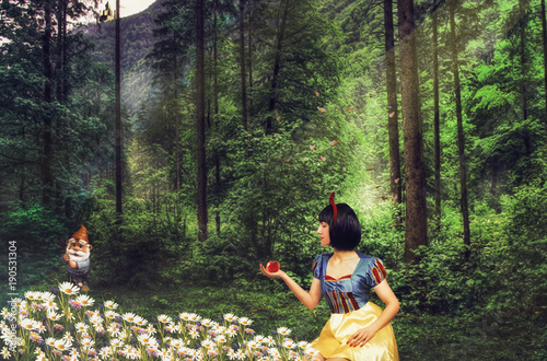 Fototapeta  Snow White in a mysterious forest holds an apple in her hand