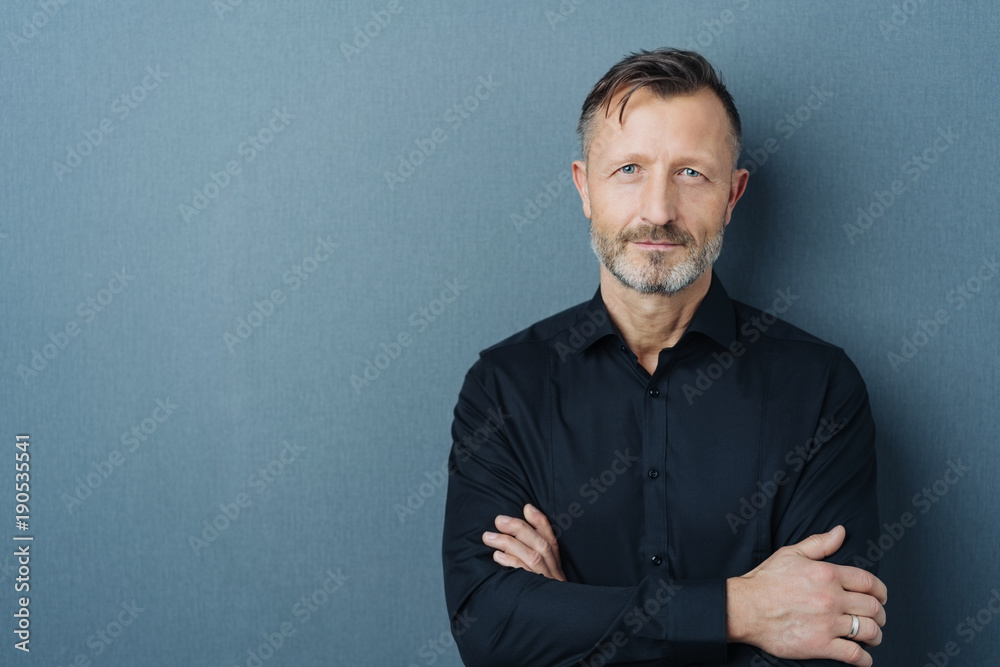 Fototapety, obrazy: Serious middle-aged man with folded arms