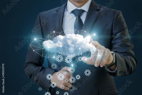 Businessman makes setting up cloud data.