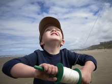 Boy On Beach With Kite