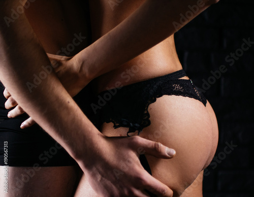 Fototapeta muscular handsome sexy guy with pretty woman, on dark background obraz na płótnie