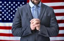 Man Praying On American Flag Background