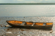 Wooden Boat Stuck In The Mud A...