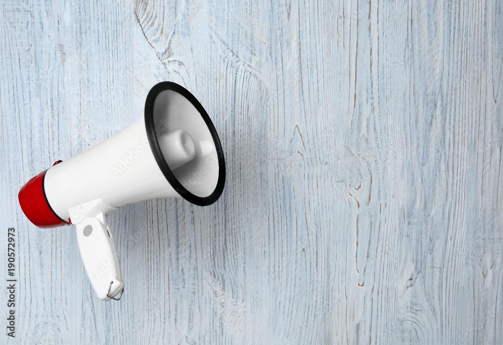 Fototapeta White megaphone on wooden background