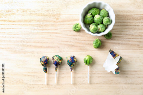 Door stickers Brussels Brussel sprouts with lollipop sticks in candy wrappers on table. April fools food