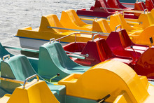 Colored Pedalos On A Lake Are Waiting For Tourists
