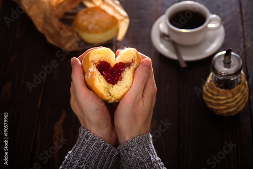 Man hands holding donut in heart shape