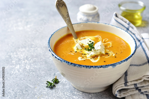 Thick pumpkin soup with feta cheese and thyme.