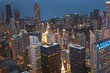 Chicago, Wind City at sunset. Aerial skyline, cityscape with rooftop buildings. Lake Michigan in sight