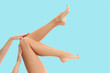 canvas print picture - Woman's legs with smooth skin after depilation on pastel background.