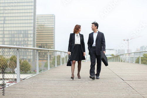 economists walk during lunch break, married American middle-aged couple going to have snack Canvas Print