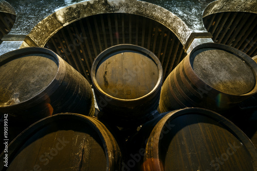 Barrels for whiskey or wine stacked in the cellar