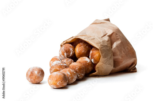 Mini  doughnuts in paper bag isolated on white