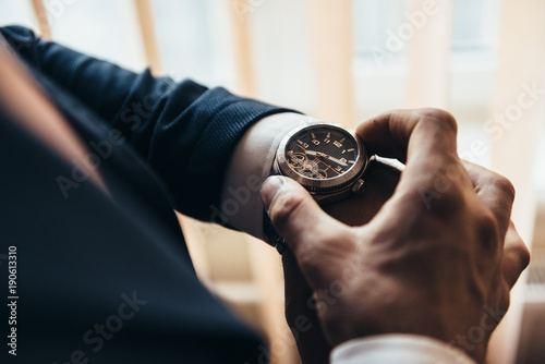 Fotografie, Obraz stylish mechanical watch on the hand of a man who watches time