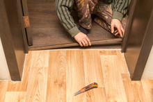 A Man Is Making A Threshold On The Floor