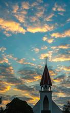 A Silhouette Of A Church Steep...