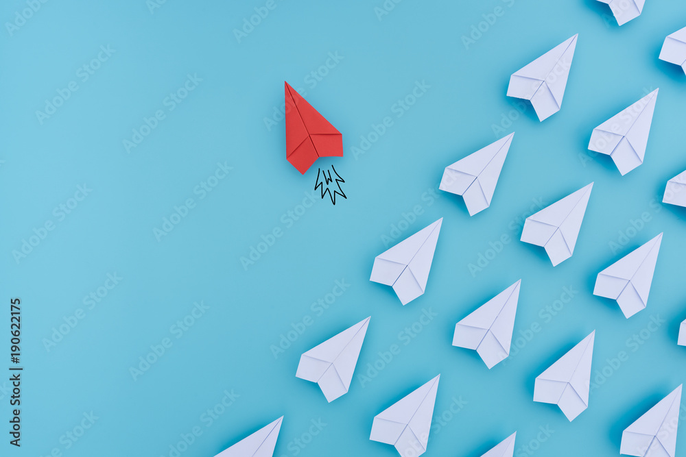 Fototapety, obrazy: Group of paper planes in one direction and with one individual pointing in the different way. Business concept for innovative solution.