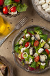 A delicious salad with sardines and feta cheese.
