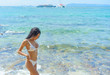 Young fashion woman relax on the beach.Summer vacation holiday.hot beautiful woman in bikini on the beach