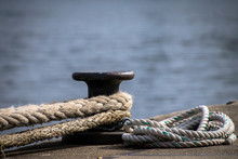 Ship Mooring Ropes Secured Aro...