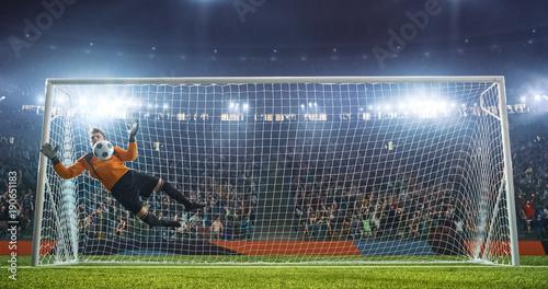 Fotobehang Voetbal Soccer goalkeeper in action on the stadium