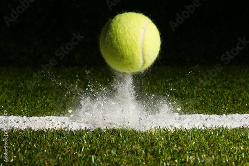 Fotografía Match point with a tennis ball hitting the line