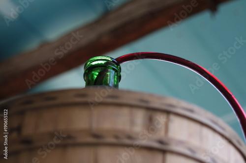 Valokuvatapetti Siphoning wine into a demijohn, carboy