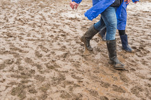 In Rubber Boots On Dirt, At The Festival