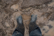 In Rubber Boots On Dirt, At Th...