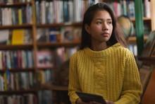 Teenage Girl Using Digital Tab...