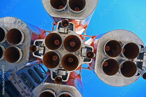 Space rocket engines of the russian spacecraft over blue sky. Cosmic hi tech background