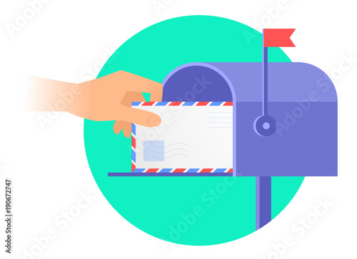 Canvas Print Human hand is taking out an envelope from a mailbox