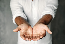 Close Up Of Man's Cupped Hands...
