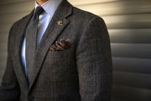 Detail Of Man In Custom Tailored Suit Posing