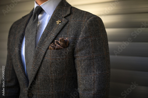 Detail of man in custom tailored suit posing