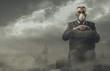Leinwandbild Motiv Businessman and polluted city