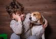 European boy and Beagle dog