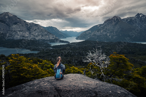 Poster de jardin Bleu nuit Woman hiker enjoys the valley view from viewpoint. Area near the city of Bariloche, Argentina