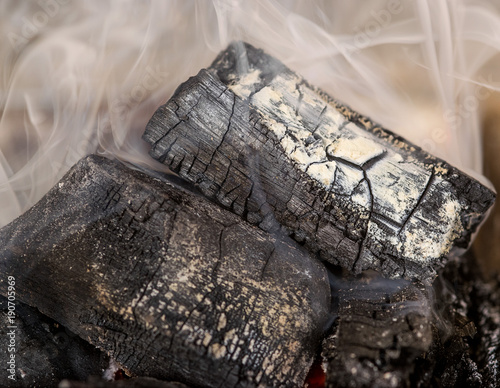 Foto op Canvas Krokodil Charcoal and coals burning, with lots of smoke, closeup macro
