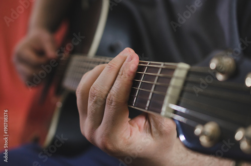 Musician hands playing chords on acoustic guitar - Buy this stock ...
