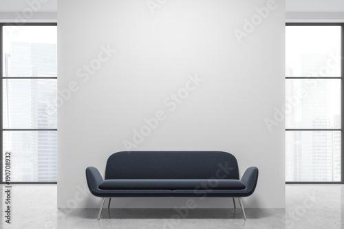 Photo Empty white loft, gray sofa