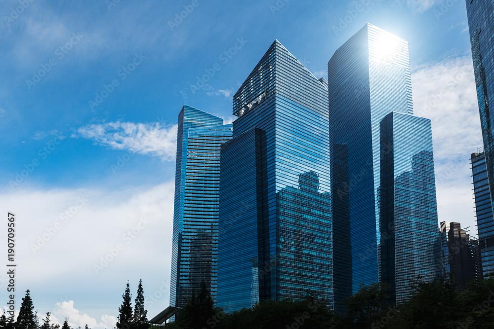Fototapeta Modern blue skyscrapers at downtown district. Business landscape background. Singapore city